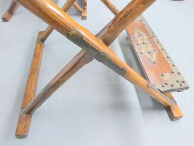 Pair of Chinese Huanghuali and metal mounted folding hunting chairs with Ox bow back rails and woven seats