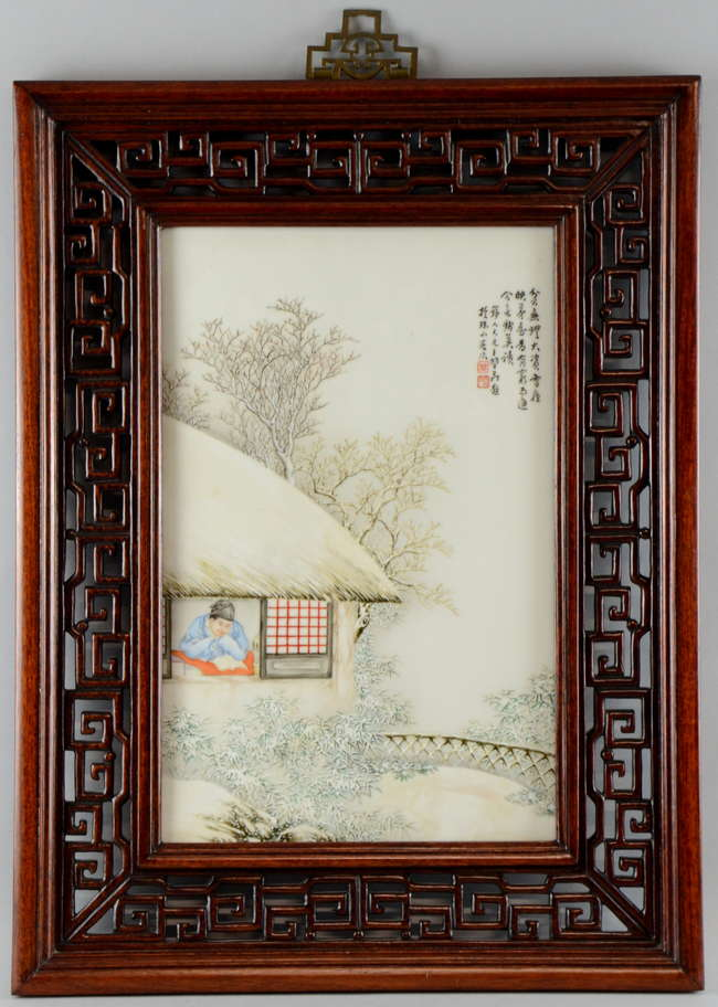 20th century Chinese porcelain plaque painted with a cottage with a figure inside in a winter landscape