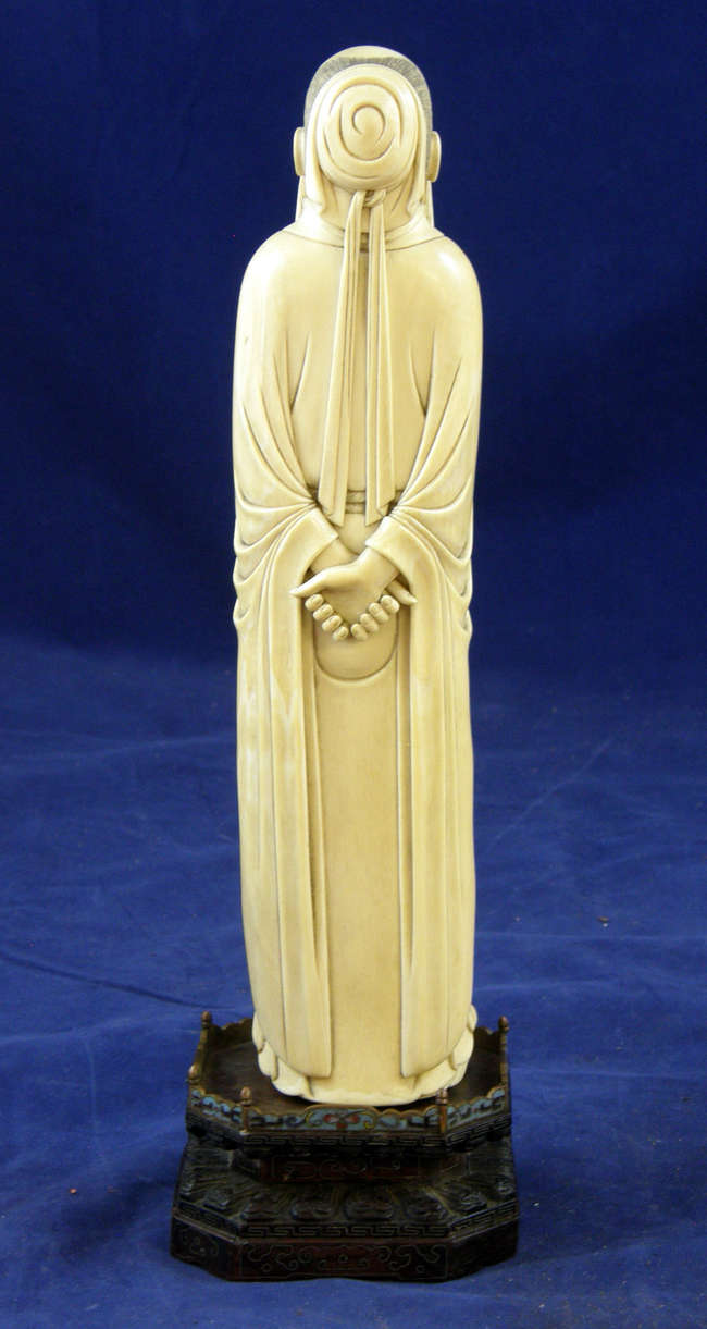 19th century carved ivory figure of Liu Po Wen standing with his hands behind his back