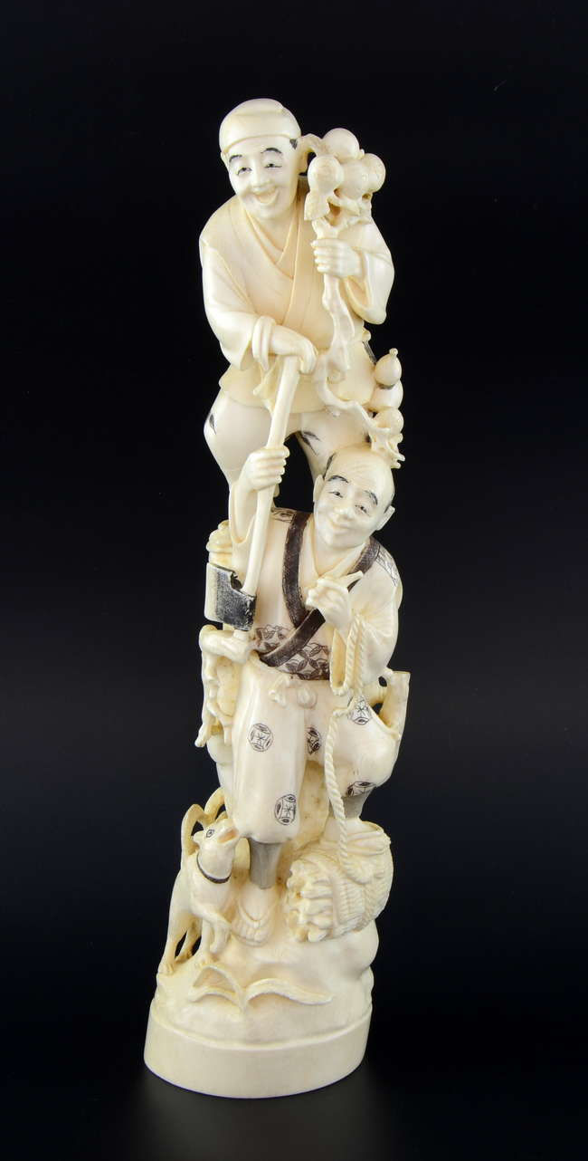 e07724119 Japanese early 20th century ivory carving of two woodmen ...