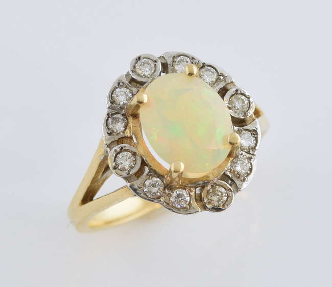 c260f9a3bf7dd0 Opal and diamond cluster ring, centrally set oval faceted opal, estimated  weight 1.65 carats