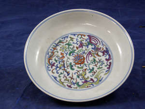 Chinese porcelain saucer dish with doucai floral decoration