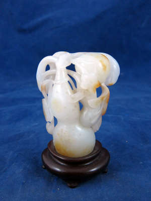 Antique Chinese white jade carving of a flowering branch fruiting with double gourd with bat detail