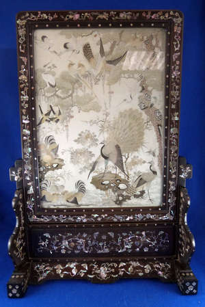 Chinese hardwood framed table screen profusely inlaid with blossom foliage fruit and birds