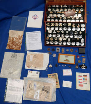 Great British Regiments a Collection of 52 solid sterling silver medals and military insignia Birmingham Mint in mahogany case 33.8oz