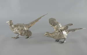 Modern silver models of a cock and hen pheasant