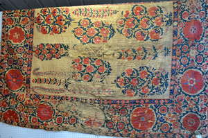 A large Ottoman  wallhanging with  formal emboidered design of flowers on linen ground