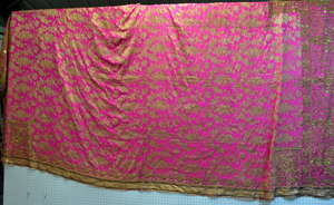 A Fine Indian wall hanging or bed cover formally the property of H. M  Queen Mary handstitched in gilt thread with brocaded fabric centre