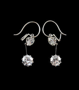 Pair of fine Art Deco diamond and platinum drop earrings transitional cut