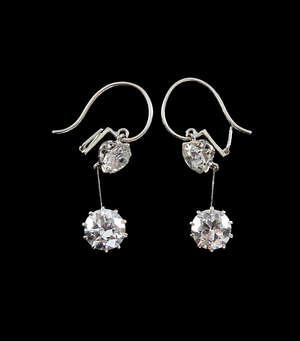 Pair of fine Art Deco diamond and platinum drop earrings transitional cut