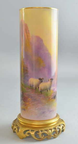 Royal Worcester cylindrical vase by Harry Davis c.1925 painted with highland landscape with sheep on reticulated base signed 10.50