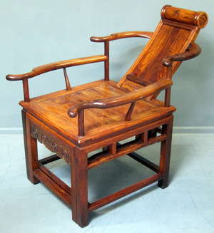 20th century Chinese carved huanghuali chair with reclining back