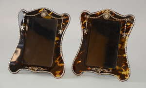 Pair of Edwardian silver and tortoiseshell easel photograph frames inlaid with pique work and applied stringing