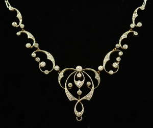 Edwardian pendant necklace millgrain set diamond in scroll forms diamond weight estimated at .6 carat tests as platinum and gold