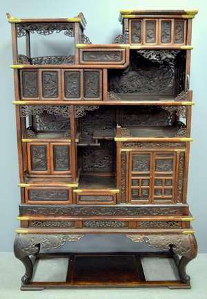 Japanese hardwood cabinet with brass mounts and extensive inlaid decoration