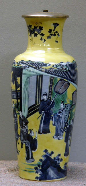 19th century Chinese yellow ground vase decorated with various figures in a landscape setting
