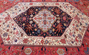 Persian red ground rug with multipled borders. the main border with Islamic script