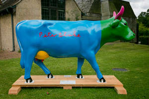 † Daisy - colourful Daisy is painted and signed by the internationally renowned artist Peter Blake. Standing cow: 95 x 29 x 57.  Artist: Peter Blake. Sponsor: Surrey Hills Trust Fund. Charity: Watts Gallery Trust.  † Please note that net proceeds