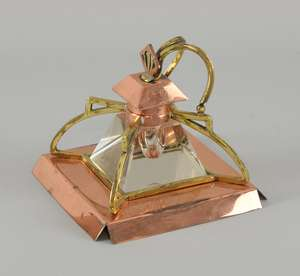 Arts & Crafts style copper and brass mounted glass inkwell on square base