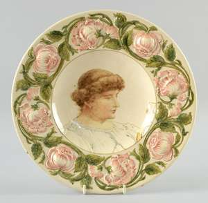 Early Doulton charger with portrait  of a young women painted by J.H. McLennan, within  a relief border of briar roses, Marked Doulton Lambeth and artists signature, 31.5 cm