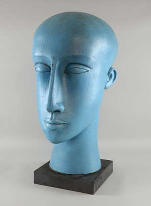§ Patricia Volk, Member of Royal British Society of Sculptors (MRBS) sculptor in  blue glazed ceramic of a head , wooden stand and pedestal, Provenance: Purchased from the artist's studio     PLEASE NOTE THAT ARTIST RESALE RIGHT MAYBE ADDITIONALLY PA
