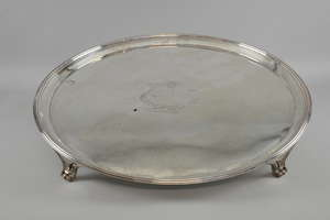 Large George III round silver tray by Daniel Smith & Robert Sharp, London, 1788, reeded border, on four panel and scroll feet, engraved with a coat-of-arms for Leigh of Ridware, 133oz, 4136g, diameter 54cm,