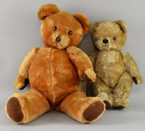 A golden plush teddy bear possibly Farnell with glass eyes, velvet pads and squeaker, 36cm long and another larger teddy bear with squeaker, 58cm long,