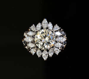 Large diamond ring, set with a round brilliant cut diamond weighing approximately 4.60cts with a surround of marquise and pear shape diamonds mounted in white metal. tested as platinum. Total diamond surround estimated weight 2.80cts