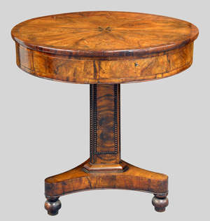 Early 19th century Maltese olivewood cross-banded drum table with radiating veneered top, the centre with a cross, four drawers, on triangular column support to tripod base with three round feet, diameter 71cms height, 72cms