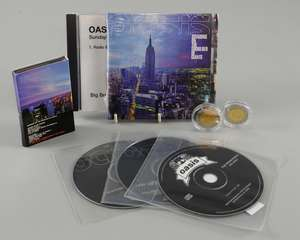 Oasis - 'Standing On The Shoulder Of Giants' promotional shop display standee 48 inches, Sealed promo CD of album & promo cassette of album, 2x Oasis coins from 2000, 'Go Let It Out (demo)/'Wonderwall (live) promo CD, 'F****** In The Bushes' 4