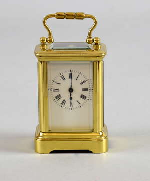 French miniature carriage clock with lever movement, the white enamelled dial with Roman numerals, back plate marked R & Co. Paris, 9.5cm high