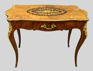 19th century French walnut and marquetry centre table with a single drawer, supported on slender cabriole legs, the whole enriched with gilt metal mounts,.103cms wide, 56cms deep and 74cms high