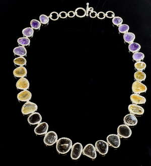 Unusual silver necklace set with unpolished gems, amethyst, citrine and smoky quartz in irregular form plaques with hammered finish mounts, unmarked, 50 cm