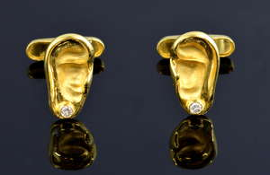 Pair of 18ct gold cufflinks in form of ears. 11 grams dia