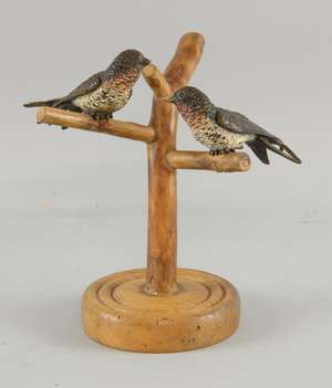 Pair of cold painted bronze swifts on later stand
