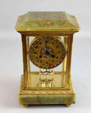 Gilt metal mounted mantel clock with twin train movement
