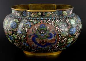 Chinese cloisonne enamelled bowl of lobed form decorated with two panels of a five clawed dragon and the flaming pearl, framed with extensive flowers, foliage and Phoenixes, impressed mark to base, 17.5cm high,
