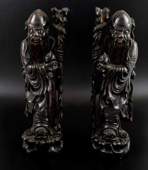 Pair of Chinese carved hardwood figures of Shou Lao holding a peach and staff