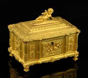 Gilt bronze casket with cherub surmount