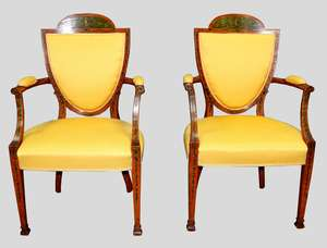 Pair of late 19th/early 20th century satinwood and yellow upholstered open armchairs with painted floral and swag decoration, on square tapering front legs