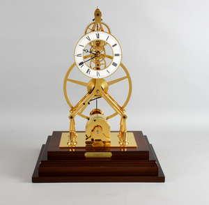 Comitti of London great wheel skeleton clock with paperwork, 45cm high