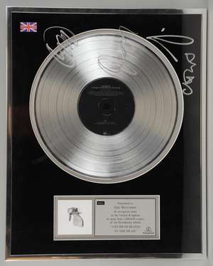 Coldplay - Signed BPI Presentation Disc for sales of more than 1,500,000 copies of the 2012 album 'A Rush Of Blood To The Head'. Presented to Guy Berryman. Signed by the band Chris Martin, Guy Berryman, Jonny Buckland and Will Champion. Framed and gl