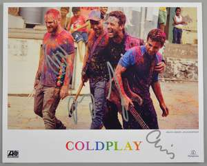 Coldplay - Atlantic / Parlophone signed promo card for the band featuring a photo of the group by Julia Kennedy. Signed in silver by the band Chris Martin, Guy Berryman, Jonny Buckland and Will Champion. 20.5 x 20cm. Ewbank's are waving any vendor co