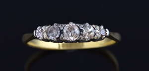 Edwardian five stone diamond ring set in platinum and 18 ct gold.  Ring size - N