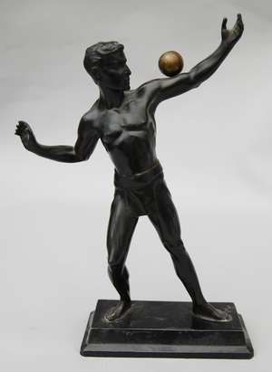 Bronze figure of an athlete balancing a ball on one arm