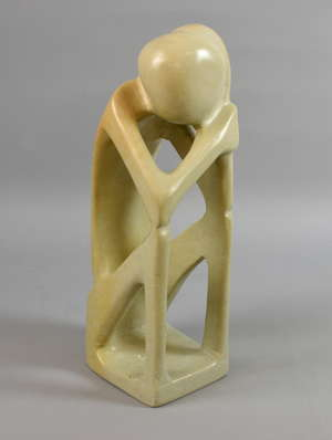 Polished stone modernistic figure of a seated man