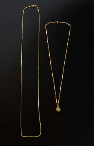 An Edwardian 9 ct gold chain and ball pendant and a 18 ct gold box chain.