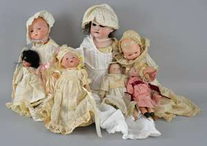 Seven Early 20th bisque head dolls to include an Armand Marseille doll