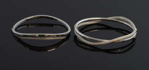 Two white hinged  gold bangles