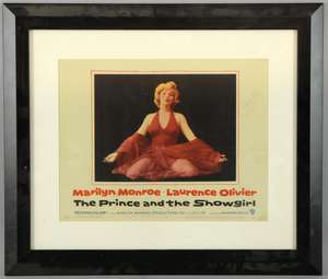 The Prince and The Showgirl (1957) US Lobby card showing Marilyn Monroe kneeling in red dress, No 8, Warner Bros, framed, 11 x 14 inches